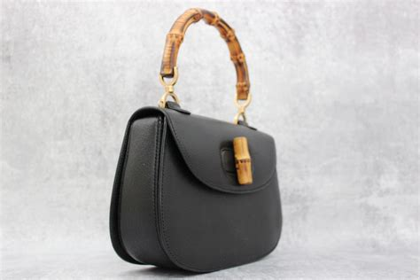 gucci black leather bamboo handle satchel  jills