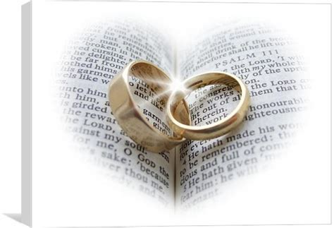 Wedding Rings On An Open Bible Canvas Print By Pete Holloway