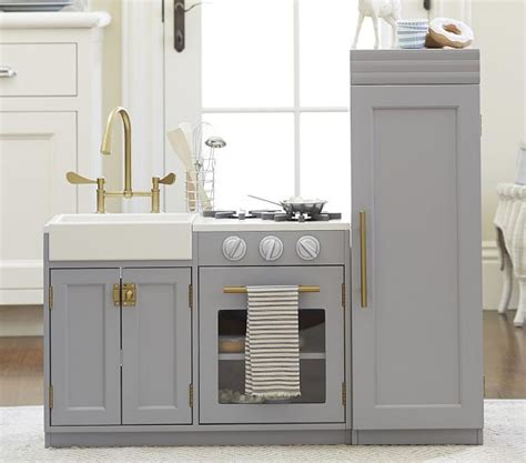 pottery barn play kitchen pint sized mdf and solid wood kitchen cabinetry from