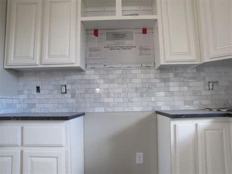 trim around kitchen cabinets do i need trim tile under the cabinets