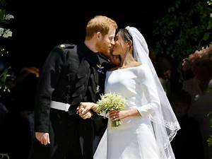 Prince Harry, Meghan Markle seal their wedding with a kiss ...