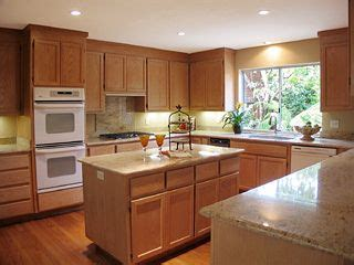 kitchens with white appliances and oak cabinets honey oak kitchen cabinets with black countertops 9860