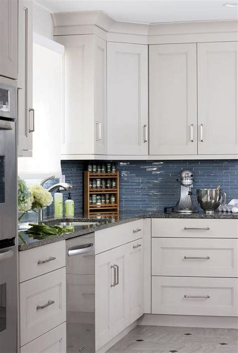 white kitchen cabinets  blue glass tile backsplash