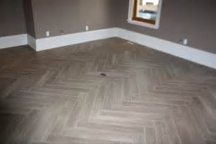 herringbone quot yes its tile quot hardwood modern family room burlington by gino dalesio