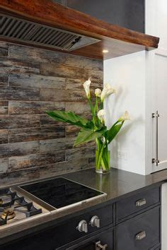 how to install a tile backsplash in kitchen porcelain floor tile with a gray woodgrain pattern is 9758