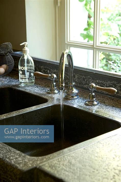 kitchen sinks trinidad and tobago gap interiors kitchen sink with water flowing from tap