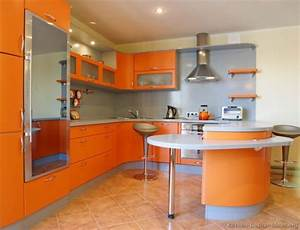 14 ideas for modern colorful kitchen decor With kitchen cabinets lowes with orange and gray wall art