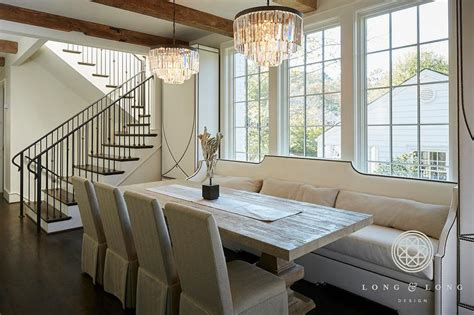 Tall Cabinets Flanking White Nailhead Dining Banquette
