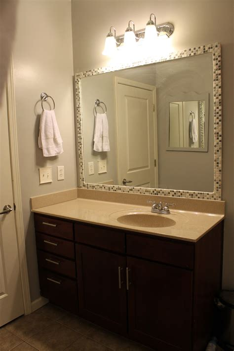 Bathroom Mirror Frame Ideas by How To Frame A Mirror With Tile Mirror Bathroom