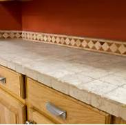 Slate Tile Countertop With A Nice Tile Border For The Backsplash Countertops For Cheap Granite Tile Countertop For Kitchen Diamond Mosaic Tiles By Granite Transformations Modernize This Kitchen This Tile Countertop Uses Medium Sized Square Tiles For A Simple And