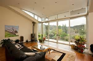 livingroom windows living room with curved ceiling wood burning fireplace store front windows