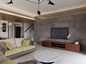 batu alam dinding tv wood ceiling ruang keluarga With living room wall tiles design
