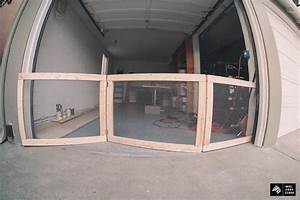 My man cave part 1 diy dog fence for garage doors for Dog door for garage door