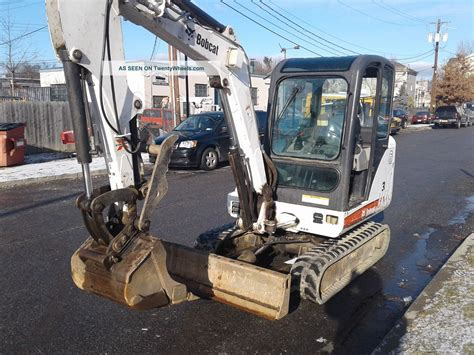 mini excavator bobcat  enclosed cab heat ac