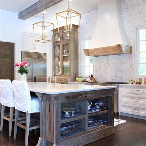 White Kitchen With Natural Wood Accents Oldseagrovehomes
