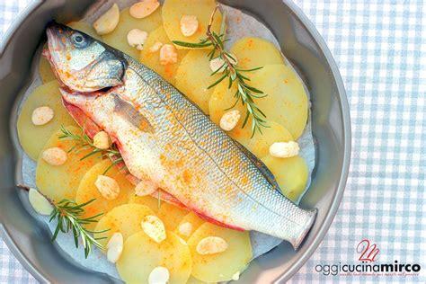 come cucinare una spigola al forno spigola al forno con odori mandorle e patate oggi