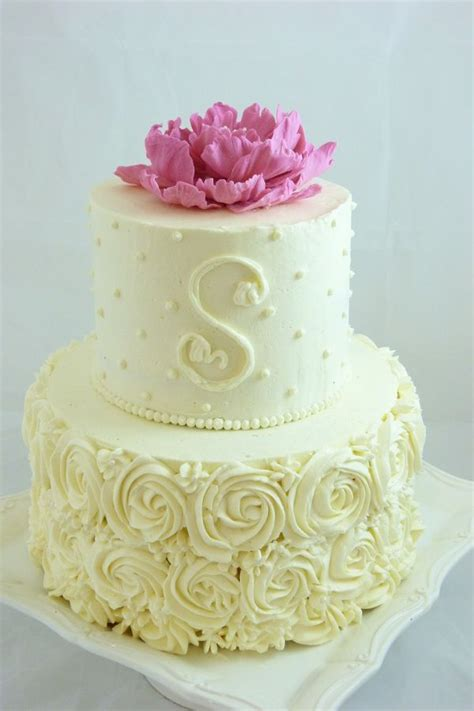 buttercream decorated small wedding cake  piped roses dots   monogram handmade gum
