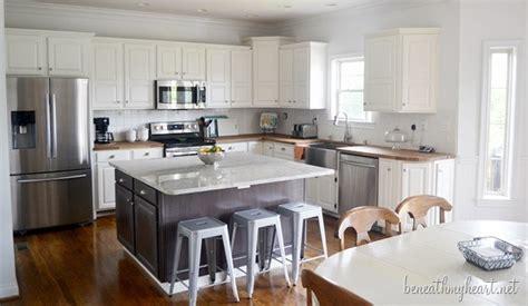 white kitchen island granite top kitchen makeover reveal beneath my