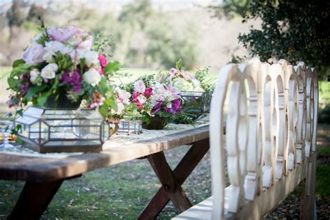 outdoor wedding reception table vintage chairs