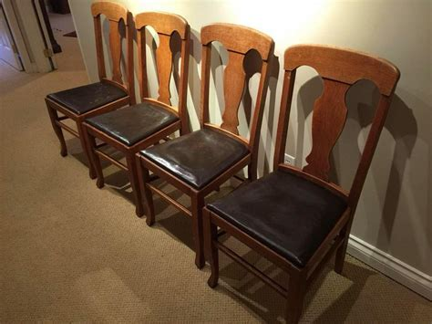 four quarter sawn oak dining chairs with leather seats
