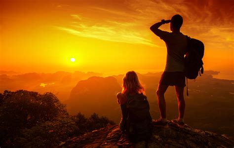 young lovers   top   mountain   sunrise
