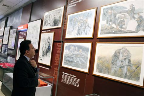 A Foreign Visitor Is Drawn To The Exhibits At The Ongoing Long March Exhibition At The China