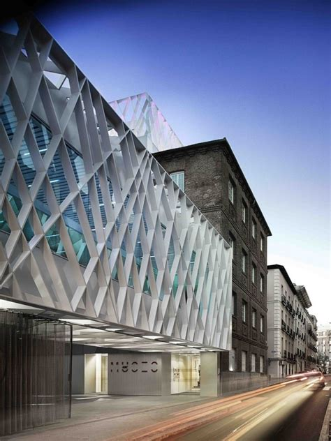 light supplying triangular holes define madrid s abc museum facade inspirationist