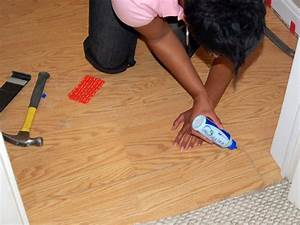 How to install a laminate floating floor how tos diy for How to lay down laminate flooring