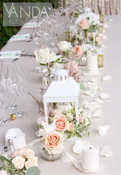 Romantic white lanterns filled with Roses and Orchids