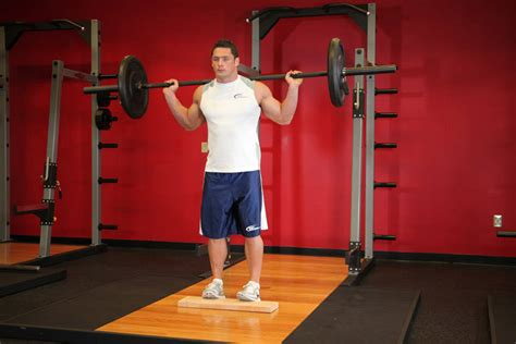 standing barbell calf raise exercise  guides bodybuildingcom