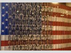American flag with faces of immigrants Ellis Island