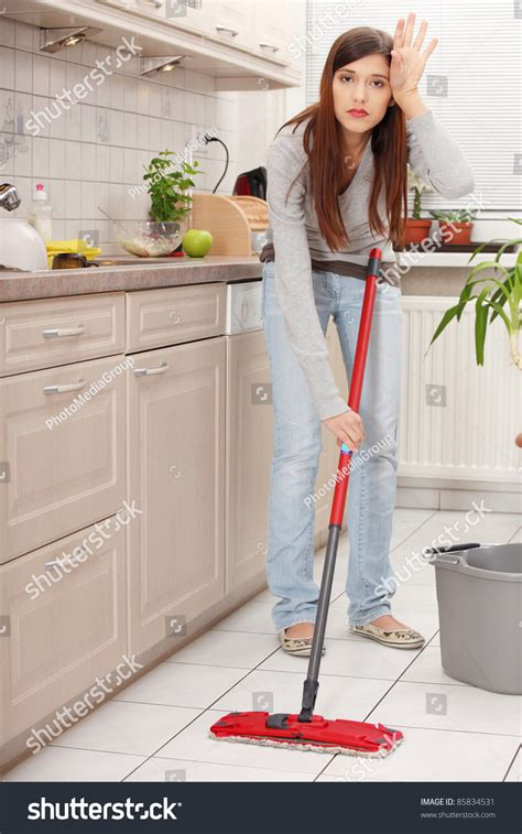 kitchen floor mops holding a mop and cleaning kitchen floor stock photo 1655