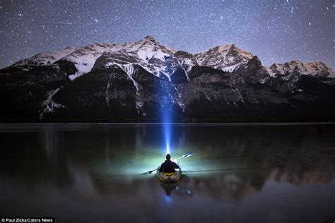stunning photographs capture  lone kayaker