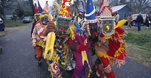 parading-participants-in-a-cajun-mardi-gras-run ...