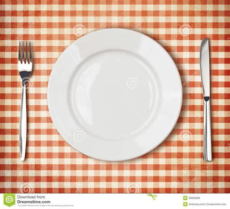 Plate, Fork, Knife Top View Over Old Tablecloth Stock