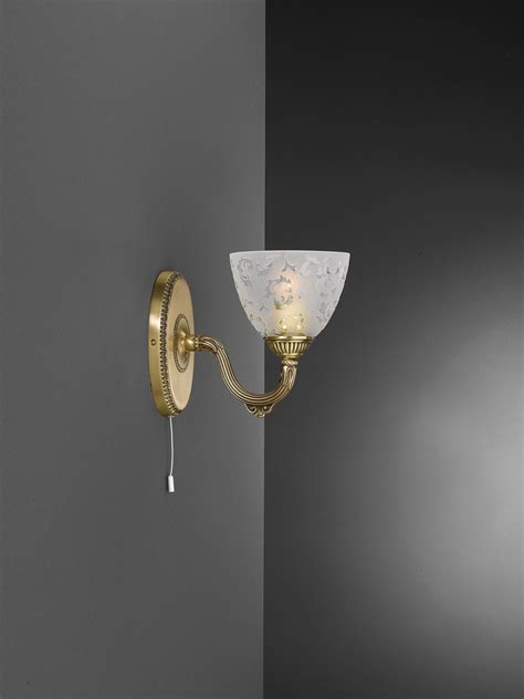 1 light brass wall sconce with frosted glass facing upward