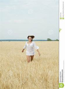 Beautiful Woman Running In A Wheat Field Royalty Free ...