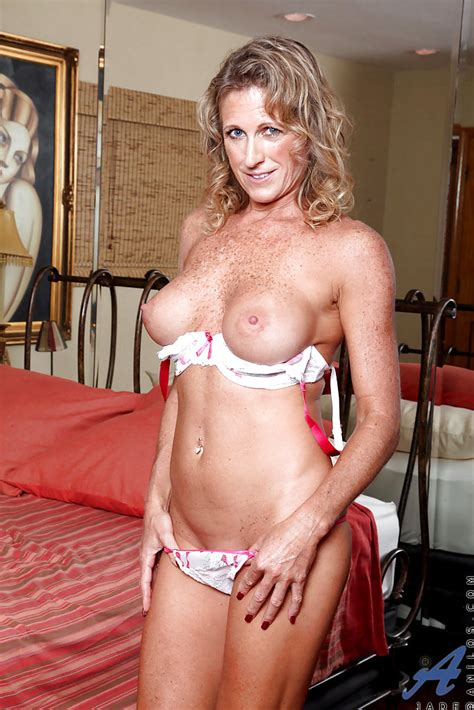 freckled mature in high heels and sexy lingerie caressing her tits and clit
