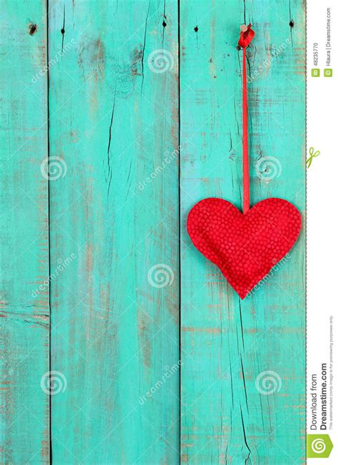 red heart hanging  ribbon  antique teal blue wooden