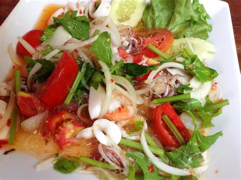 This fresh and lively summer salad mixes grapefruit and shrimp with fresh summer vegetables and thai green salad makes a wonderfully cooling side dish to spicy thai curries and other thai recipes but is. How to make Spicy Thai Seafood Salad (Yum Talay) - Recipe ideas… - The Fair Trade Store Blog