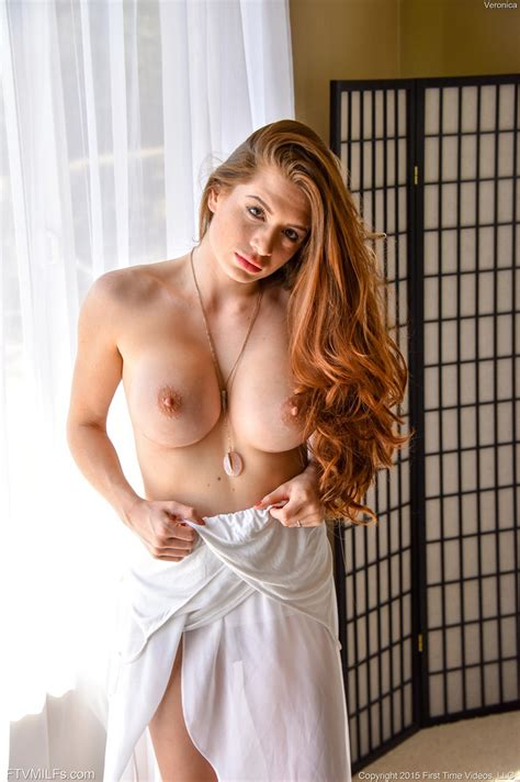 Hot Redhead With Big Tits Showing Nipples Shaved Pussy
