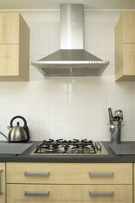 how high should kitchen cabinets be from countertop what height to put a range hood hunker