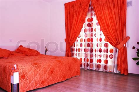 bedroom with pink walls curtains and bedspread