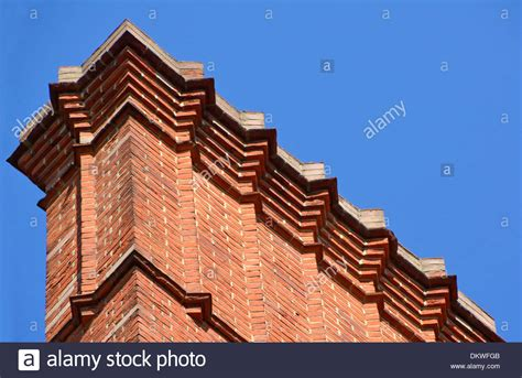 Elaborate Brick Corbelling Below (out Of View) Flue Pots
