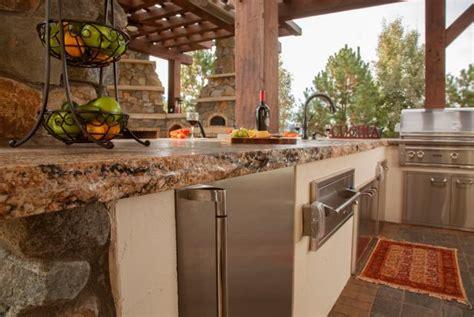 raw edge granite countertops  rustic outdoor kitchen hgtv