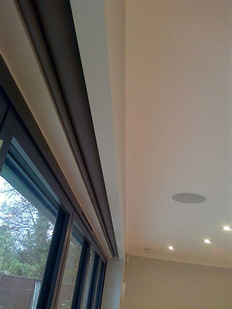 electric blinds covering bifold doors hidden