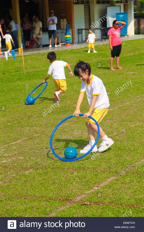 are the drag the race at a kindergarten 389   kids are playing the drag the ball race at a kindergarten sport day DKMTCH