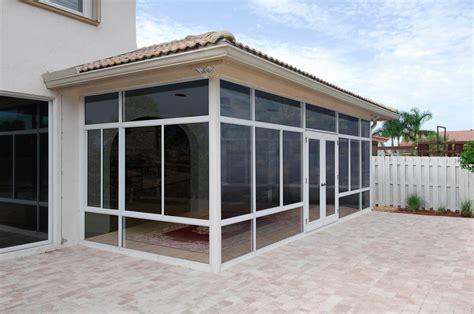 hybrid solid roof solarium or patio enclosure