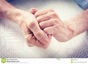 Old people holding hands. stock image. Image of arthritis ...