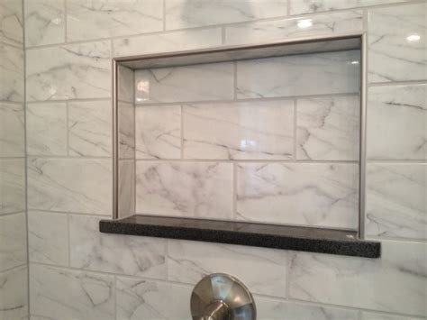 schluter tile trim white faux carrara tiles traditional bathroom charleston